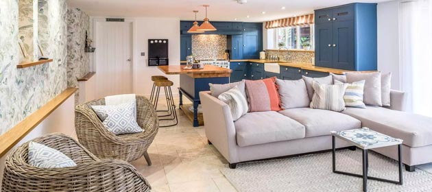 Dorset holiday cottage coral interiors open plan bliue kitchen